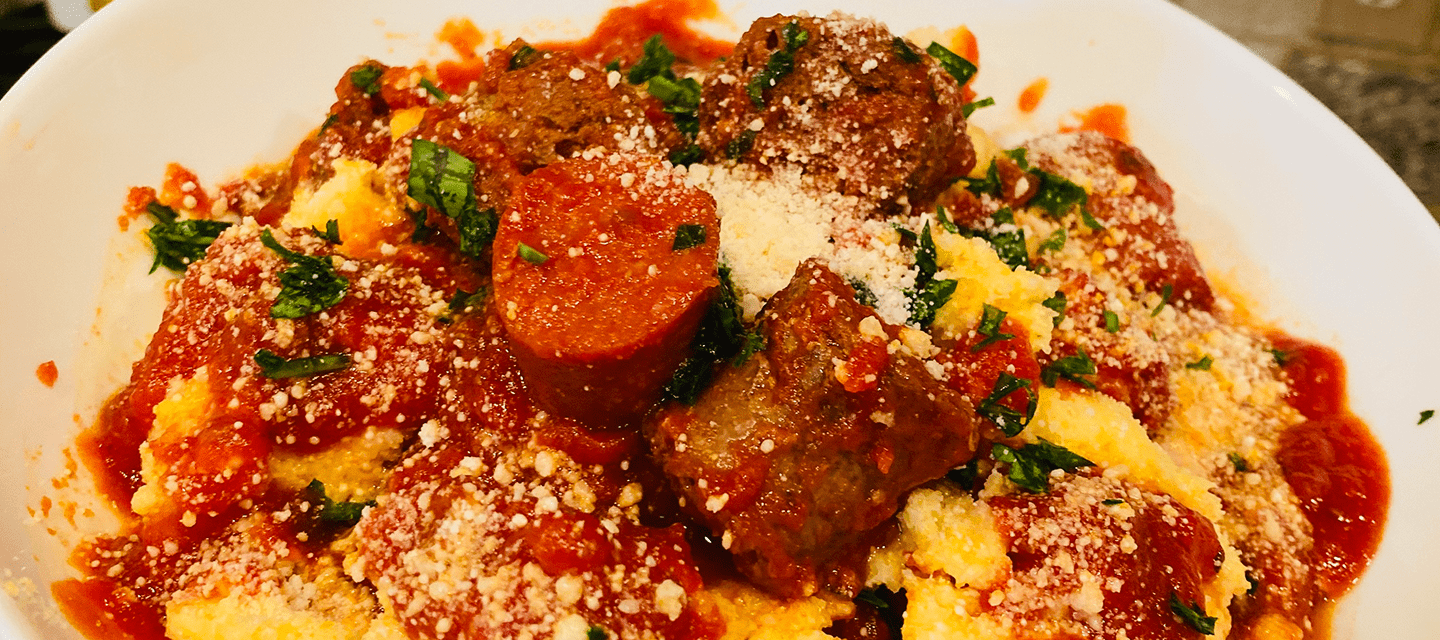 Creamy Cheesy Polenta with Spicy Sausage and Pepperoni Gravy